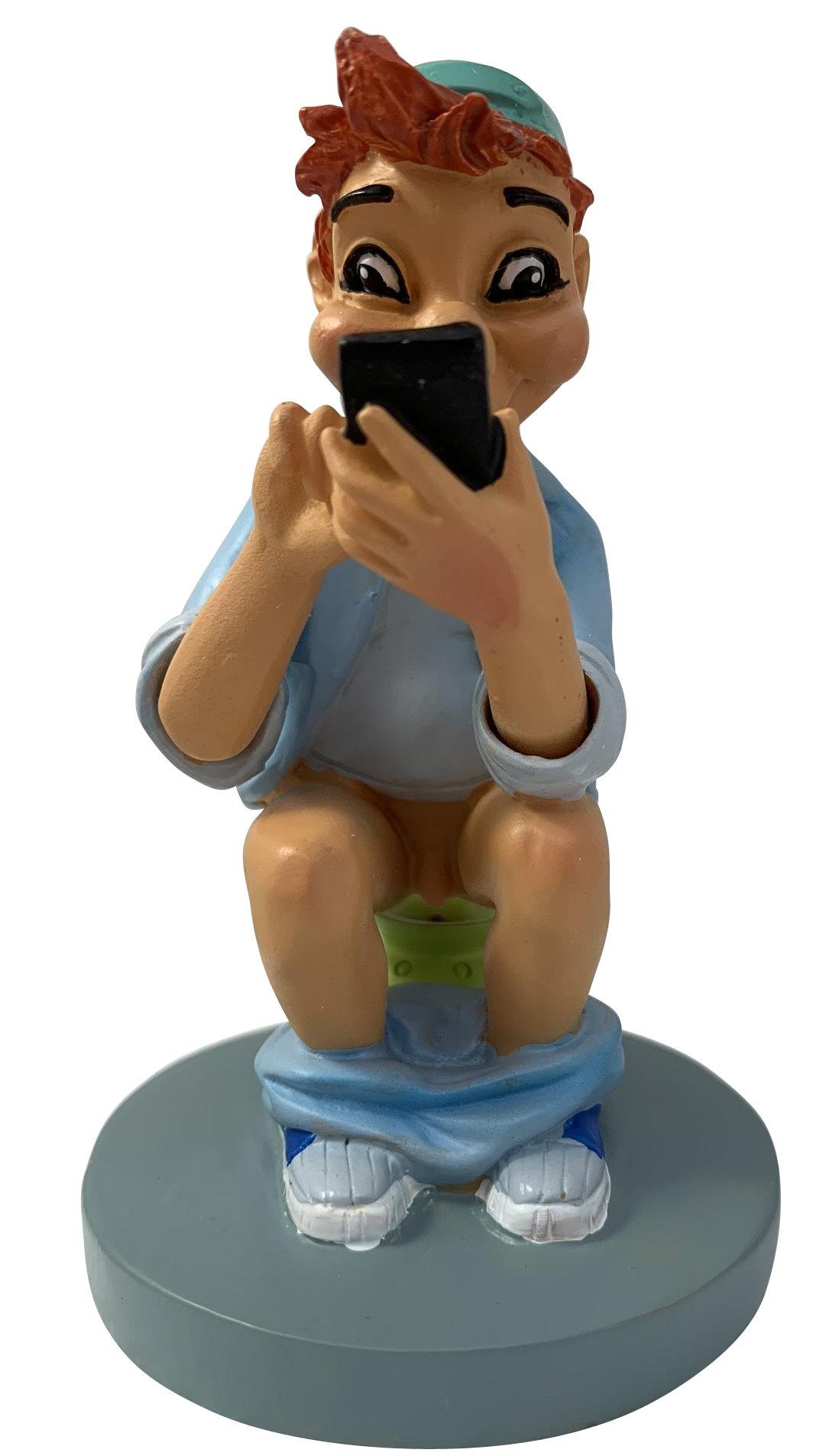 Caganer Emilio mit Smartphone auf Nachttopf